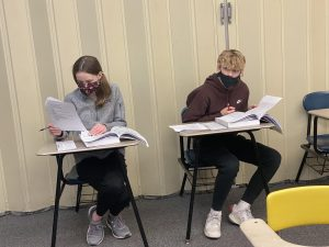 Carter Anderson and Claudia Jacobson in class